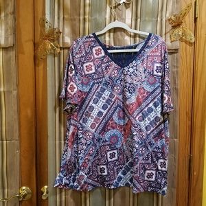 Paisley top with knitted accent.